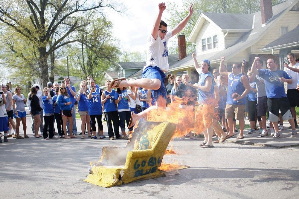 PHOTOS: Fans burn couches, celebrate after UK win in Elite 8