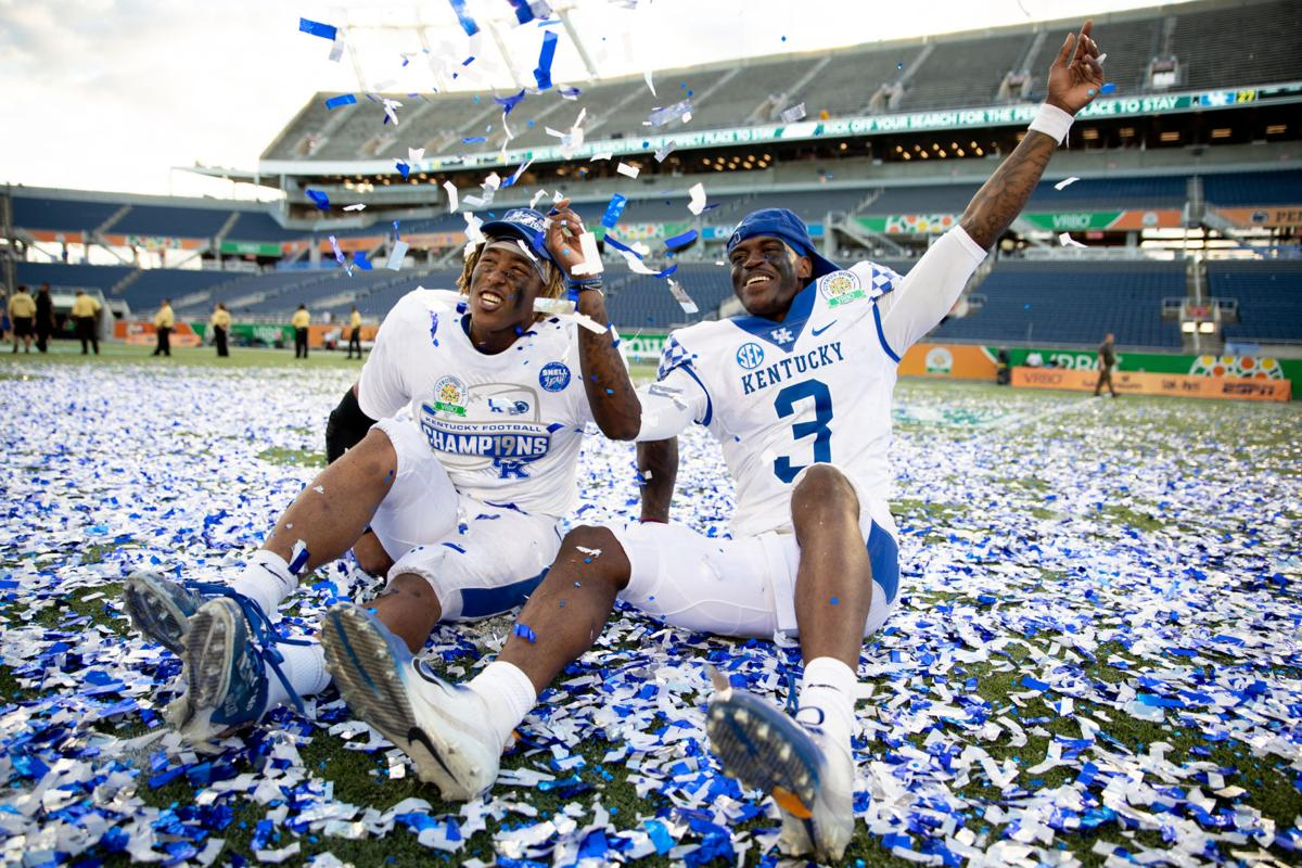 a87cd56c4e6 Kentucky Wildcats running back Benny Snell Jr. (26) and Kentucky Wildcats  quarterback Terry Wilson (3) celebrate with confetti after the game.