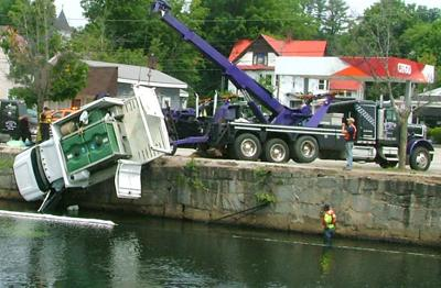 Truck goes in river, rescuers jump in to help | Local News