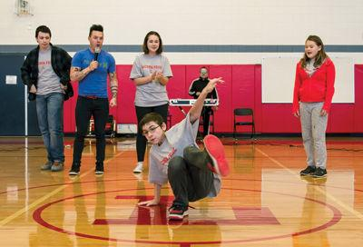 Recycled Percussion makes a surprise visit to Laconia Middle School