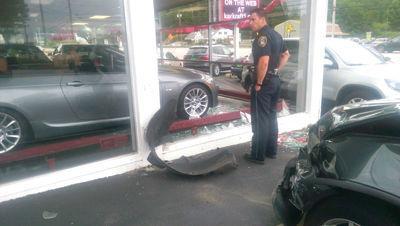 Through the glass - Car crashes German Motor Sports showroom | Local