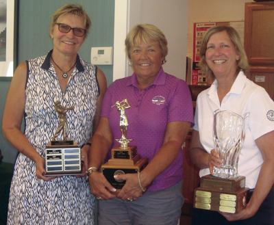 08-03 GOLF Champions with trophies