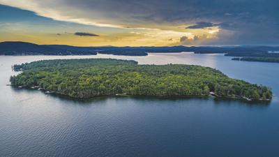 Looking west over Welch Island, Gilford towards the sunset.