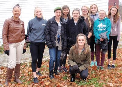 Gilford High School students helped give food pantry a spring clean-up