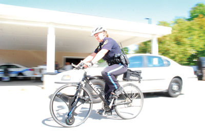 Laconia Police officers try out power-assisted bicycle for patrols