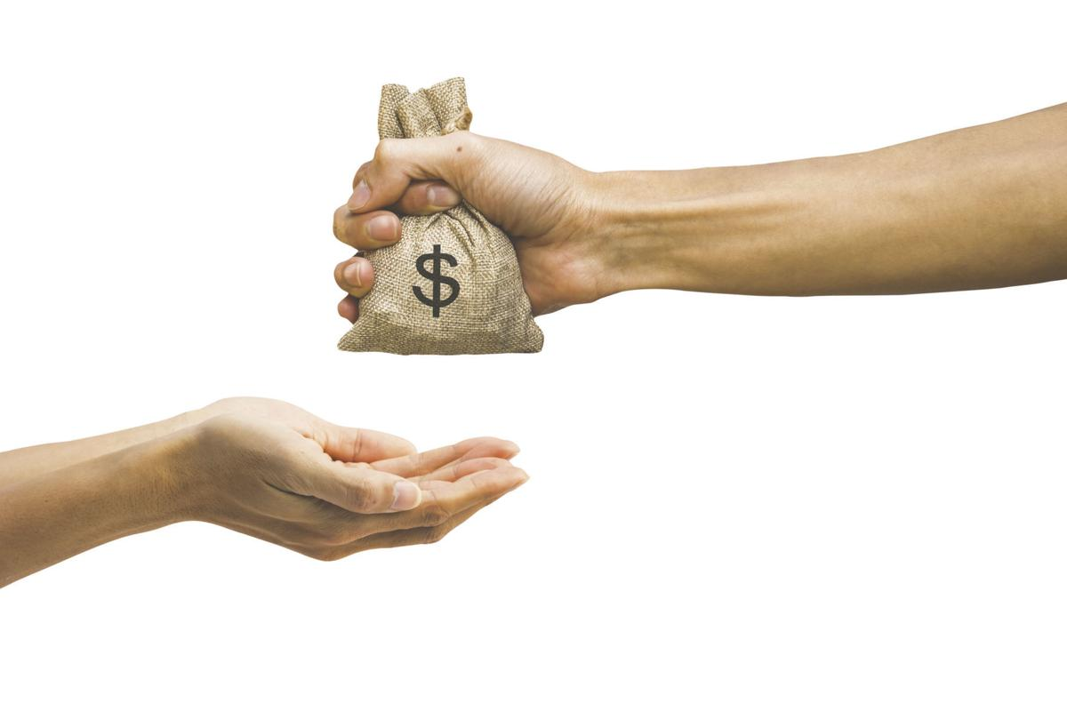 Man hand holding money bag and giving money to another person is