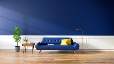 Modern interior of living room, blue sofa on wood flooring and dark blue wall ,3d rendering