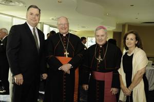 Tim Boyle, Cardinal Timothy Dolan, Archbishop Robert Carlson and Suzanne Boyle