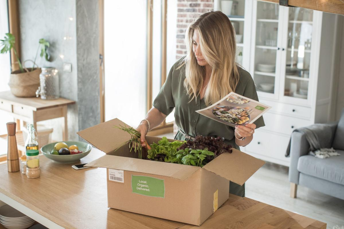 Woman got package from meal delivery service.