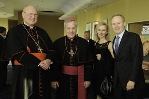 Cardinal Timothy Dolan, Archbishop Robert Carlson, Ann and Bill Corrigan