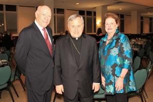 Darryl and Ellen Ross, Archbishop Robert J. Carlson