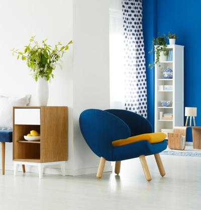 Blue chair in white room