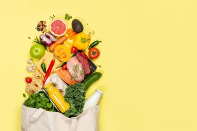 Grocery shopping concept - foods with shopping bag