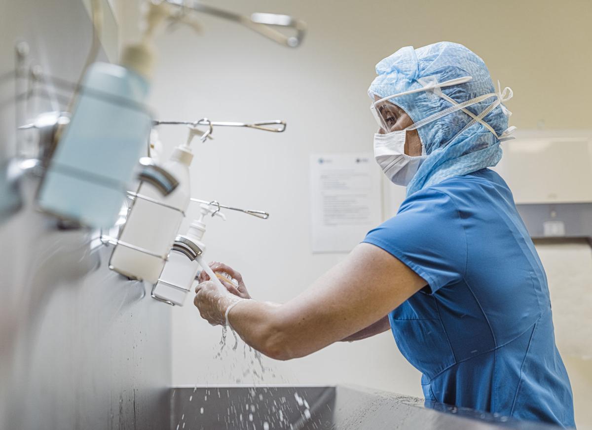 Nurse washing hands to avoid Covid 19 virus.