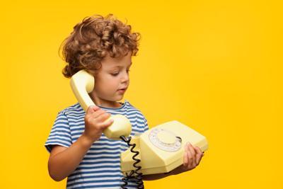Boy talking obsolete phone
