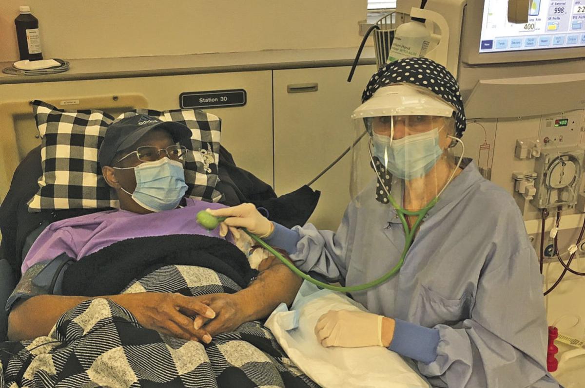 Karen Kirk , RN with patient.jpg