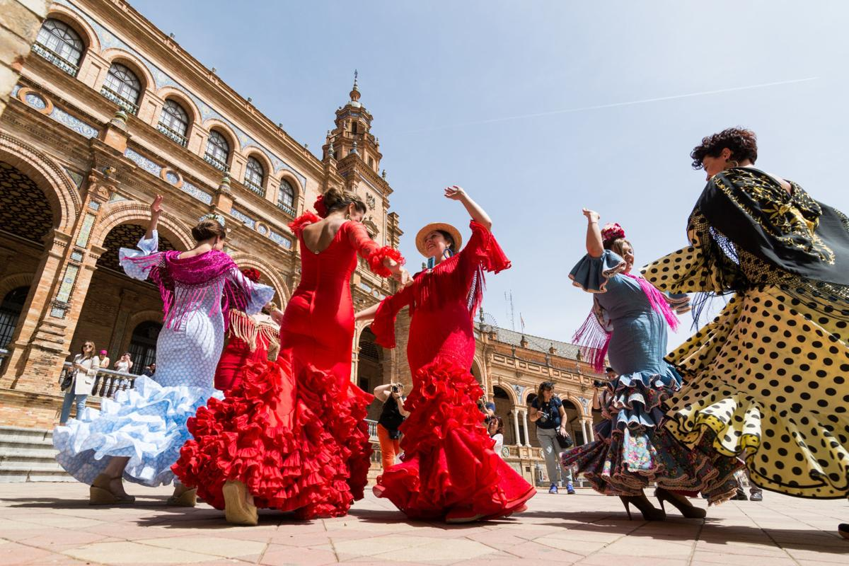 Young women dance flamenco on Plaza de Espana in Seville, Spain
