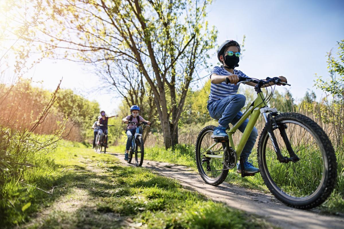 Family enjoying a bike trip during COVID-19 pandemic