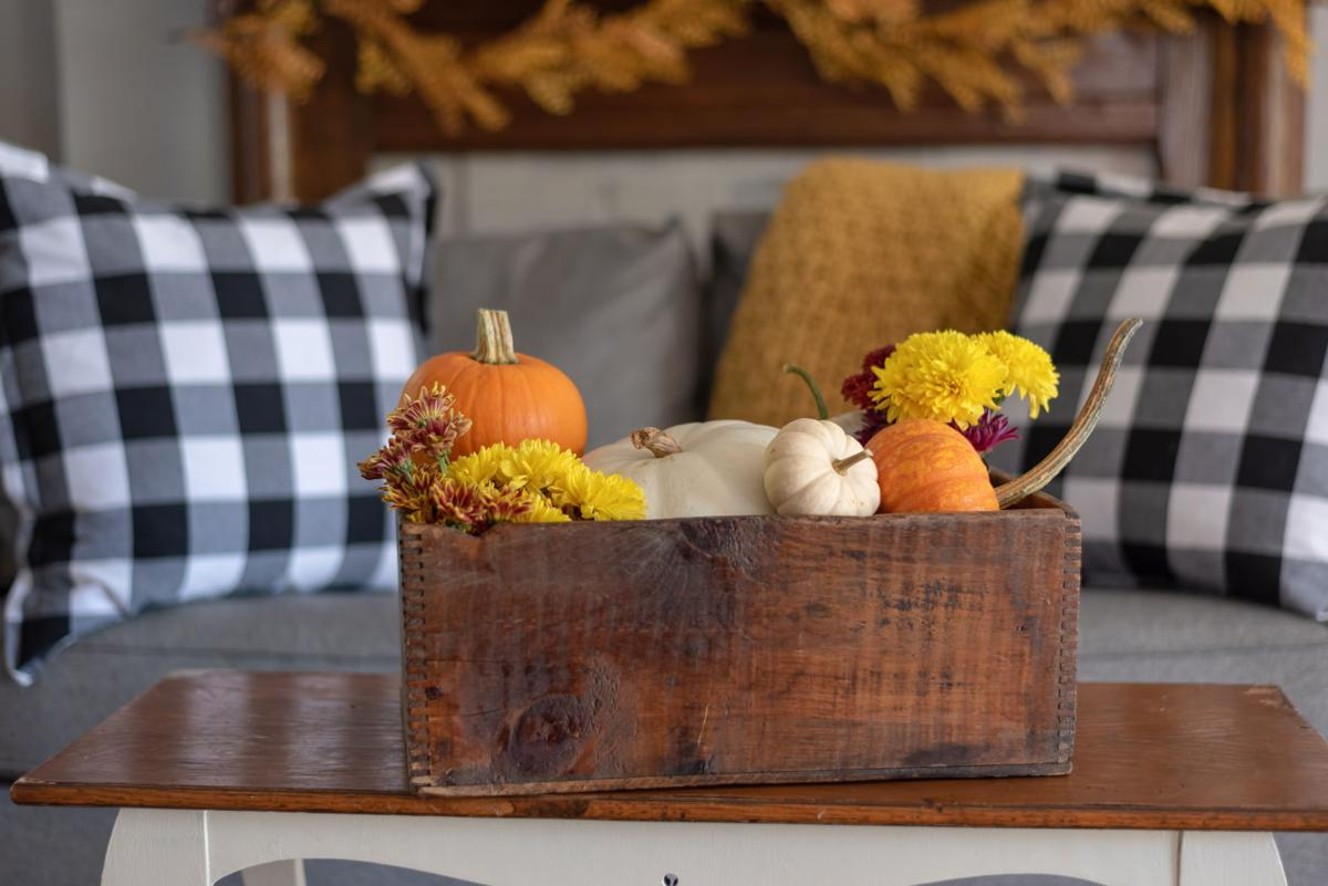 Vintage wooden crate filled with pumpkins - decorating the home for fall