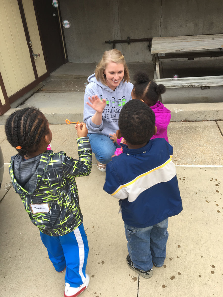 Staff member Heather engages with children at parent training.JPG