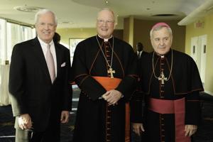 Pat Sly, Cardinal Timothy Dolan, Archbishop Robert Carlson