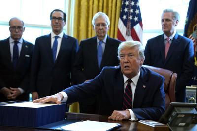 trump signing.jpg