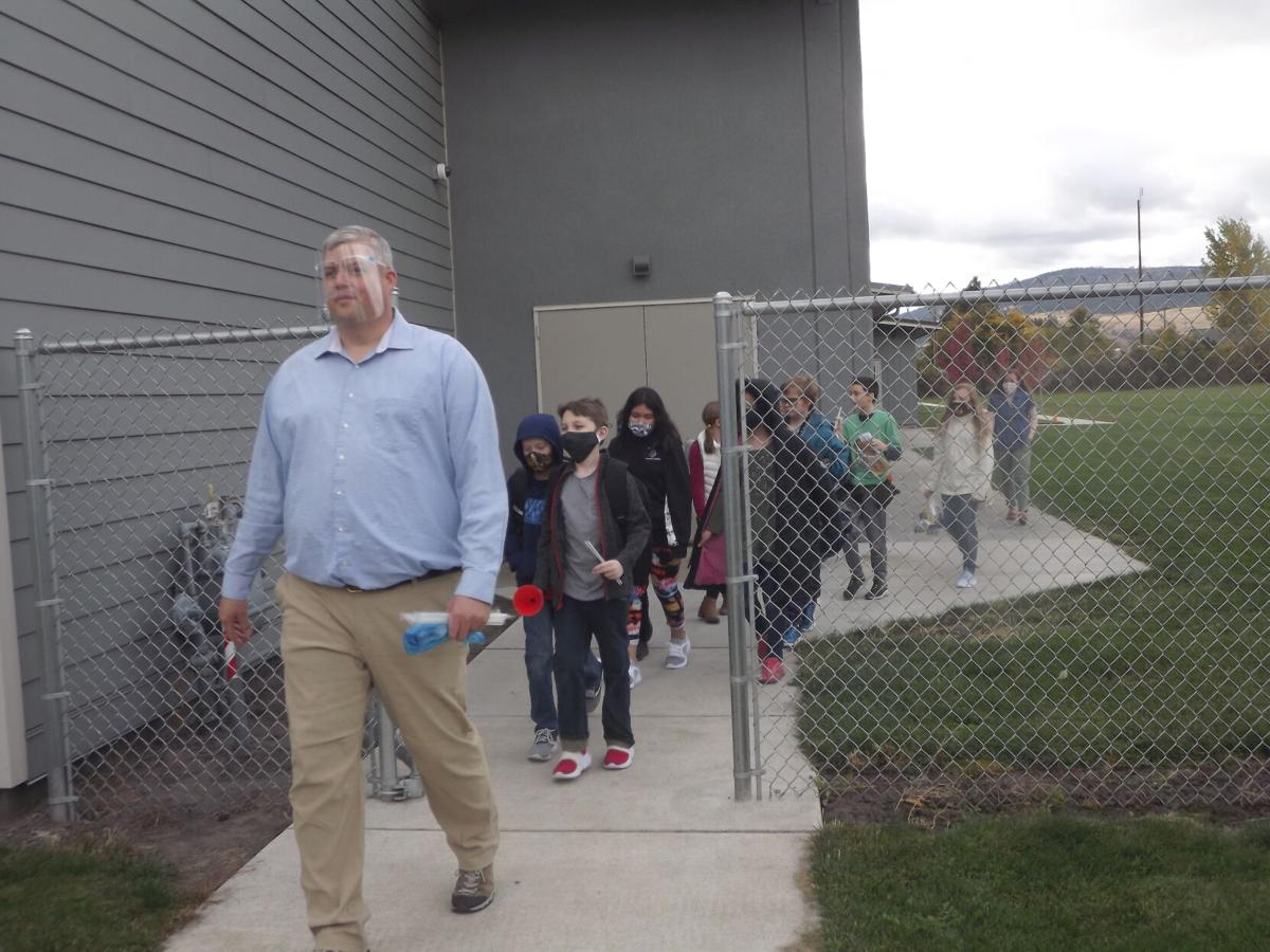 Island City Elementary fifth-grade teacher Darren Hendrickson leads students.JPG