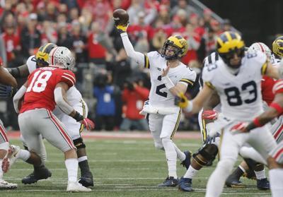 Nov. 24, 2018, Michigan quarterback Shea Patterson throws a pass .jpg