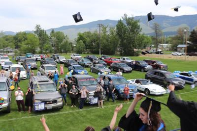 Cove High School graduates toss their caps