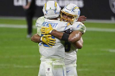 Los Angeles Chargers tight end Hunter Henry embraces quarterback Justin Herbert .jpg