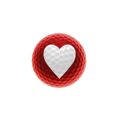 Red golf ball with a white heart