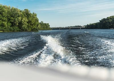 trace tail of speed boat on water surface in the river