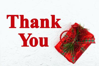 Thank You message with red Christmas present with pine cones