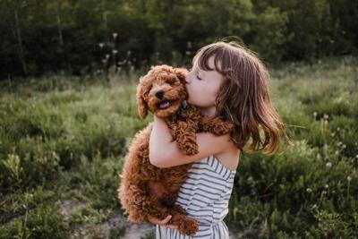 girl with dog puppy
