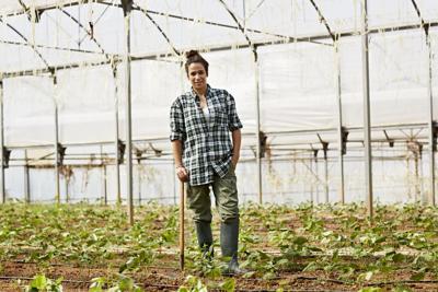 Female farmer standing in greenhouse