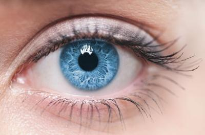 A close-up of a blue female human eye