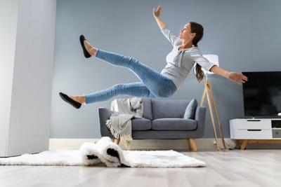 Woman Legs Stumbling With A Carpet