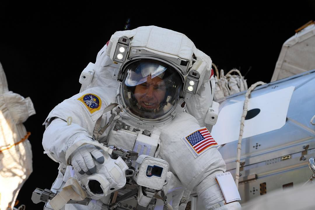 an astronaut goes out for a space walk - photo #23