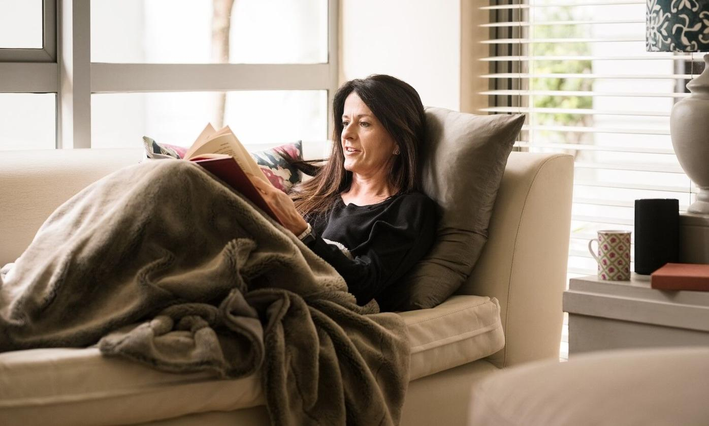 Lady on couch reading.jpg