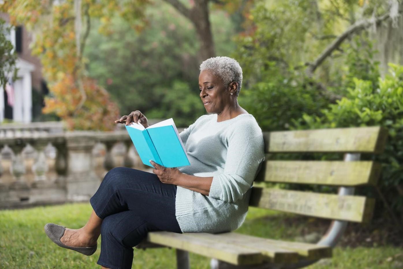 Lady on park bench reading.jpg