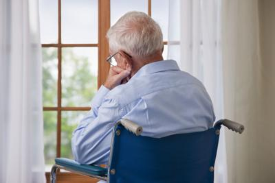 senior citizen looking out the window (copy)