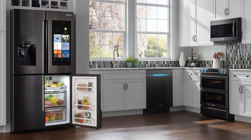 Samsung Electronicsu0027 Family Hub Refrigerator Is The Center Of This Photo  Set Kitchen, Which Also Includes Appliances With The Trending Matte Black  Finish ...
