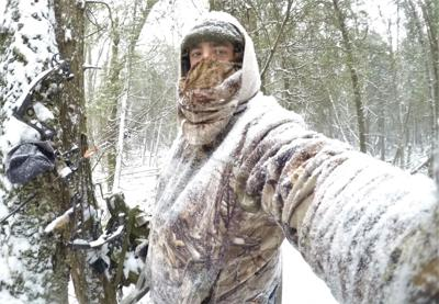 deer hunter in the snow
