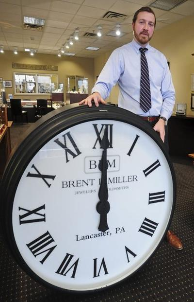 Jeweler donates antique-type clocks to train station to honor his father
