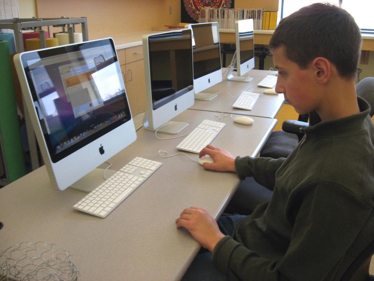 Student Alan Rockwell works on a computer in the art room at the newly renovated Janus School.