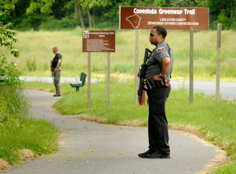 Police with rifles in Lancaster County Central Park after faked kidnapping.