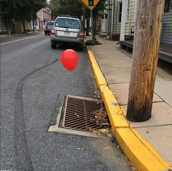 'Terrified' police remove 'It' balloons from sewer grates