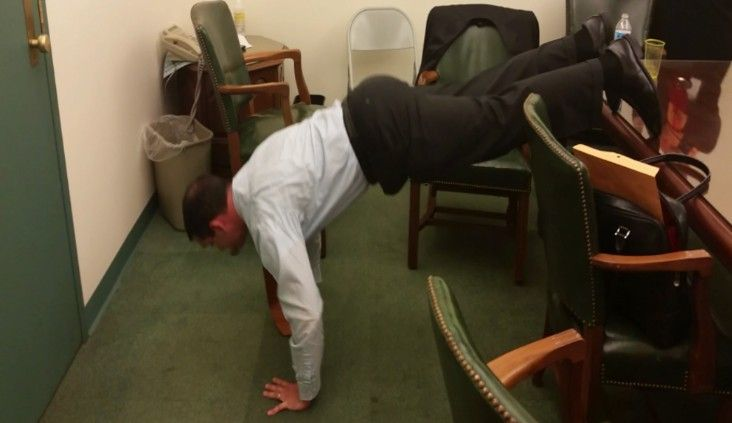 Eugene DePasquale does pushups in LNP's conference room