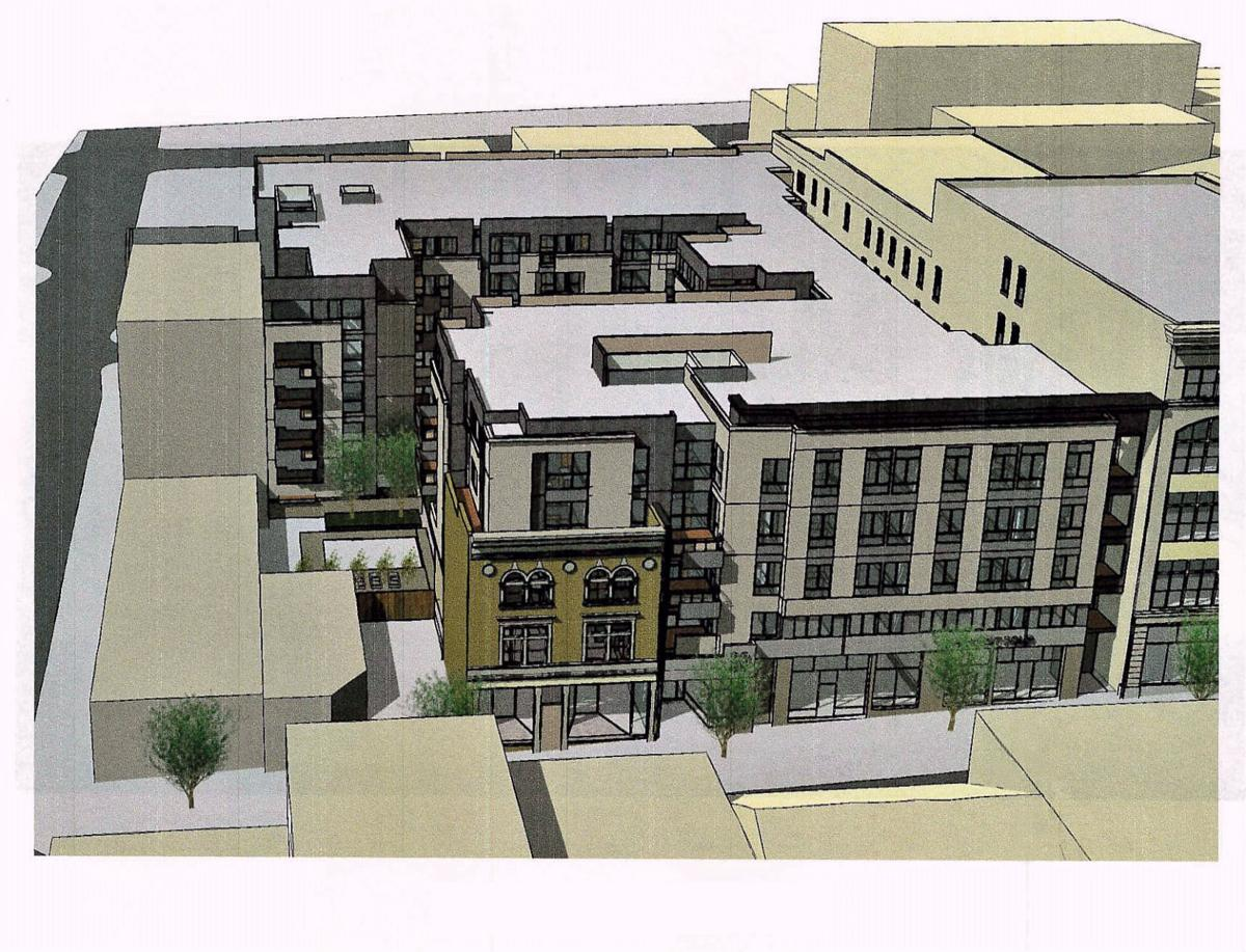 Downtown parking lot eyed for possible apartment complex with ground-floor retail