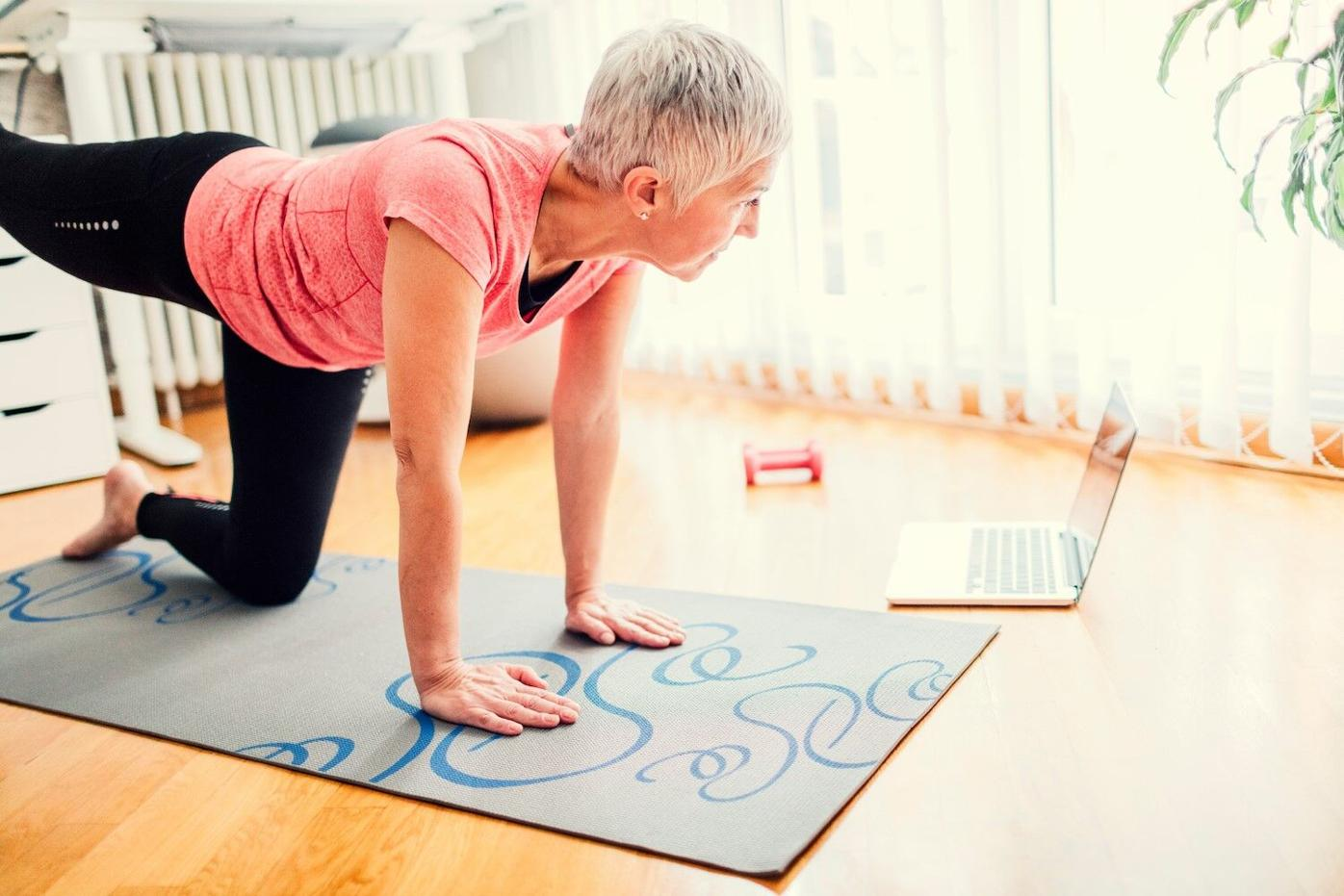Woman doing yoga with a tablet.jpg